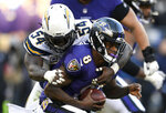 Los Angeles Chargers defensive end Melvin Ingram (54) sacks Baltimore Ravens quarterback Lamar Jackson in the second half of an NFL wild card playoff football game, Sunday, Jan. 6, 2019, in Baltimore. (AP Photo/Nick Wass)