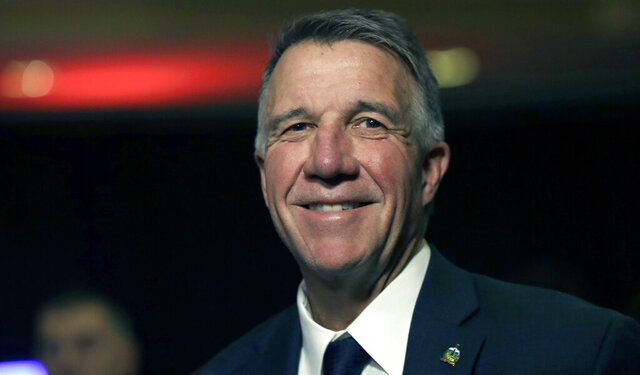 FILE- In this Nov. 6, 2018 file photo, Republican Vermont Gov. Phil Scott smiles during an election night rally party in Burlington, Vt. Scott announced, Thursday, May 28, 2020, that he is running for re-election, but won't hire staff, actively campaign or raise money until the current state of emergency because of the coronavirus is lifted. (AP Photo/Charles Krupa)