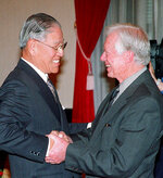 FILE - In this March 30, 1999, file photo, former U.S. President Jimmy Carter, right, shakes hands with Taiwan President Lee Teng-hui before delivering a speech in Taipei. Local media are reporting that ex-Taiwanese President Lee Teng-hui, who oversaw the island's transition to full democracy, has died. Lee was 97 and had largely dropped out of public life in his later years. (AP Photo/Pool)