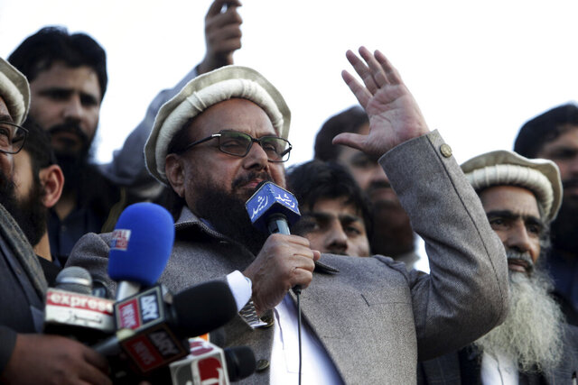 "FLE - In this Feb. 5, 2019 file photo, Hafiz Saeed, chief of Pakistani religious group Jamaat-ud-Dawa, addresses a rally in Lahore, Pakistan. The United Nations has freed up ""expense"" money for several men designated as terrorists at the request of the Pakistani government, including one Saeed. Pakistan's Foreign Ministry said in a statement Wednesday, July 15, 2020 the money will cover basic expenses and doesn't involve any restoration or unfreezing of bank accounts. (AP Photo/K.M. Chaudary, File)"
