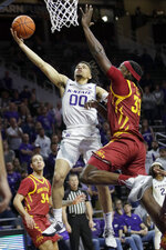 Kansas State guard Mike McGuirl (00) makes a basket while covered by Iowa State forward Solomon Young (33) during the second half of an NCAA college basketball game in Manhattan, Kan., Saturday, March 7, 2020. (AP Photo/Orlin Wagner)