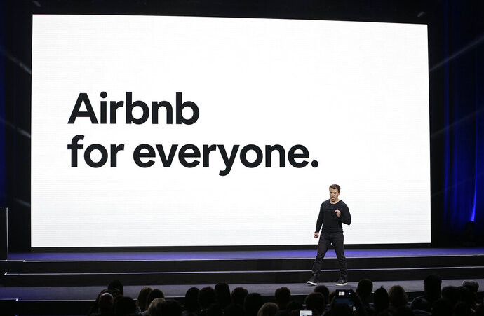 FILE- In this Feb. 22, 2018, photo, Airbnb co-founder and CEO Brian Chesky speaks during an event in San Francisco. Airbnb will ban some younger U.S. guests from booking homes in their area as part of a continuing effort to crack down on unauthorized parties. The San Francisco-based home sharing company said U.S. guests under age 25 with fewer than three positive Airbnb reviews won't be allowed to book entire homes close to where they live. (AP Photo/Eric Risberg, File)