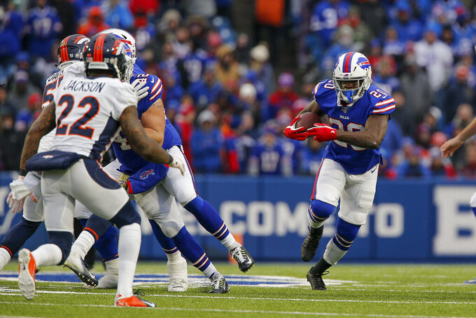 Buffalo Bills running back Frank Gore (20) runs against the Denver Broncos during the fourth quarter of an NFL football game, Sunday, Nov. 24, 2019, in Orchard Park, N.Y. (AP Photo/John Munson)