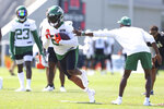 New York Jets running back Tevin Coleman (22) runs a drill during practice at the team's NFL football training facility, Saturday, July. 31, 2021, in Florham Park, N.J. (AP Photo/Rich Schultz)