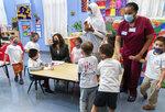 Vice President Kamala Harris joins bilingual early childhood education school CentroNia pupils during a visit to the school, Friday, June 11, 2021 in northwest Washington. (AP Photo/Manuel Balce Ceneta)