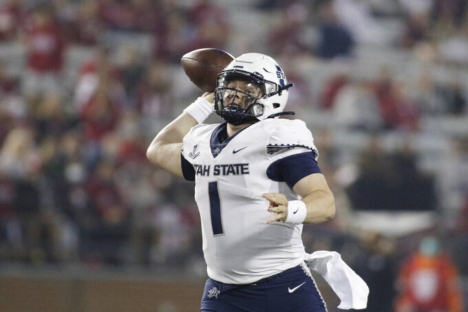 Utah State quarterback Logan Bonner throws a pass during the second half of an NCAA college football game against Washington State, Saturday, Sept. 4, 2021, in Pullman, Wash. Utah State won 26-23. (AP Photo/Young Kwak)