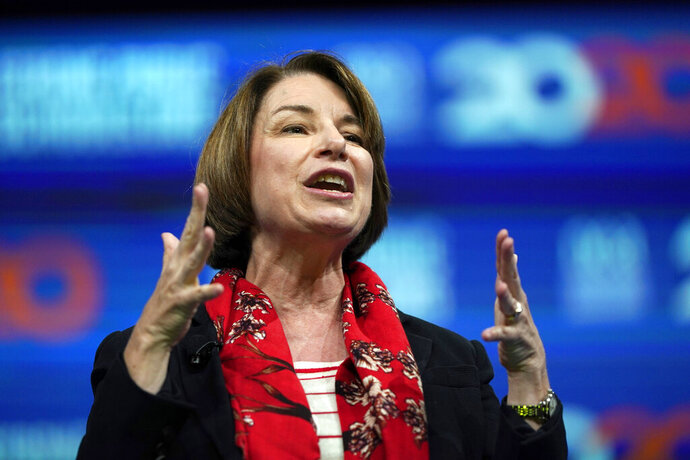 FILE - In this July 5, 2019, file photo Democratic presidential candidate Sen. Amy Klobuchar, D-Minn., speaks during the National Education Association Strong Public Schools Presidential Forum in Houston. Klobuchar has a new plan to help seniors that includes more support for people with Alzheimer's and their caregivers. It's an issue that's personal for the Minnesota senator, whose 91-year-old father is in a memory care facility. (AP Photo/David J. Phillip, File)