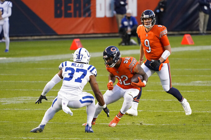 Chicago Bears' David Montgomery (32) runs against Indianapolis Colts strong safety Khari Willis (37) during the second half of an NFL football game, Sunday, Oct. 4, 2020, in Chicago. (AP Photo/Nam Y. Huh)