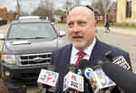 Retired Bishop Airport police Lt. Jeff Neville speaks to reporters outside the federal courthouse in Flint, Mich., Thursday, April 18, 2019.  Amor Ftouhi, of Canada, convicted of terrorism for nearly killing Neville in June 2017, was sentenced Thursday to life in prison after defiantly declaring he had no regrets and only wished he had carried a machine gun that day instead of a knife. (AP Photo/Ed White)