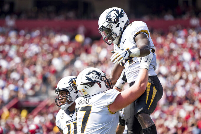 Missouri running back Larry Rountree III, right, celebrates a touchdown with Paul Adams (77) during the first half of an NCAA college football game against South Carolina Saturday, Oct. 6, 2018, in Columbia, S.C. (AP Photo/Sean Rayford)