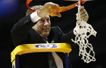 Michigan State head coach Tom Izzo cuts down the basketball net after defeating Duke in an NCAA men's East Regional final college basketball game in Washington, Sunday, March 31, 2019. (AP Photo/Patrick Semansky)