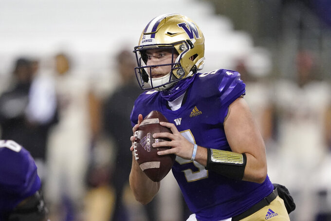 Washington quarterback Dylan Morris looks for a receiver during the first half of the team's NCAA college football game against Oregon State, Saturday, Nov. 14, 2020, in Seattle. (AP Photo/Ted S. Warren)