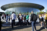 People arrive at Apple for an event to announce new products Tuesday, Sept. 10, 2019, in Cupertino, Calif. (AP Photo/Tony Avelar)