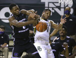 Baylor guard Mark Vital (11) and Central Arkansas forward SK Shittu (0) reach for the loose ball in the first half of an NCAA college basketball game, Tuesday, Dec. 29, 2020, in Waco, Texas. (AP Photo/ Jerry Larson)