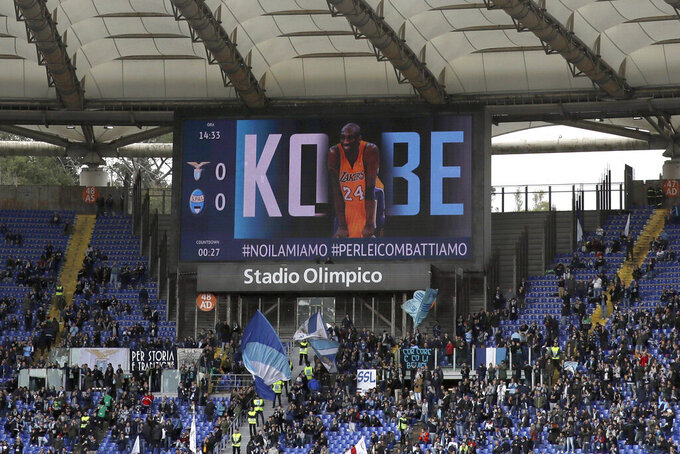 A picture of Kobe Bryant is projected on a giant screen prior to the Serie A soccer match between Lazio and Spal, at Rome's Olympic stadium, Sunday, Feb. 2, 2020. (AP Photo/Alessandra Tarantino)