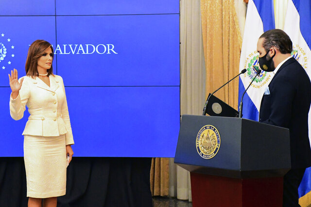 In this In this photo released by the El Salvador Presidential Press Office, Salvadoran President Nayib Bukele swears in Milena Mayorga as the country's next ambassador to the U.S., at Government House, in San Salvador, El Salvador, Thursday, Sept. 24, 2020.  A top 10 finalist in the 1996 Miss Universe pageant, Mayorga is a political neophyte with no previous diplomatic experience, having been elected to congress for the first time in 2018. (El Salvador Presidential Press Office via AP)