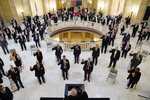 FILE - In this Wednesday, Nov. 11, 2020 file photo, House members participate in a ceremonial swearing-in ceremony at the state Capitol in Oklahoma City. At least 187 state legislators nationwide have tested positive for the virus and four have died since the pandemic began, according to figures compiled by The Associated Press. Twelve Arkansas lawmakers have tested positive for the virus over the past month, the second largest known outbreak in a state legislature. (AP Photo/Sue Ogrocki, File)