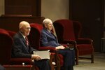 In this photograph provided by The Church of Jesus Christ of Latter-day Saints shows President Russell M. Nelson, right, sitting next to his counselor, Dallin H. Oaks, left during The Church of Jesus Christ of Latter-day Saints' twice-annual church conference Saturday, April 4, 2020, in Salt Lake City. The conference kicked off Saturday without anyone attending in person and top leaders sitting some 6 feet apart inside an empty room as the faith takes precautions to avoid the spread of the coronavirus. A livestream of the conference showed a few of the faith's top leaders sitting alone inside a small auditorium in Salt Lake City, Normally, top leaders sit side-by-side on stage with the religion's well-known choir behind them and some 20,000 people watching. (The Church of Jesus Christ of Latter-day Saints via AP)