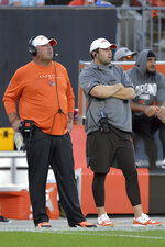 Cleveland Browns coach Freddie Kitchens, left, and quarterback Baker Mayfield watch during the first half of the team's NFL preseason football game against the Detroit Lions, Thursday, Aug. 29, 2019, in Cleveland. (AP Photo/David Richard)