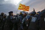 French police officers remove pro-Catalan independence demonstrators blocking a major highway border pass near La Jonquera between Spain and France, Tuesday, Nov. 12, 2019. Protesters following a call to action by a secretive pro-Catalan independence group have closed off both sides of the AP7 highway at the major transportation hub of La Jonquera between France and Spain. (AP Photo/Joan Mateu)