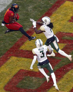 Iowa State wide receiver Deshaunte Jones (8) leaps to catch a touchdown pass over Baylor safeties Verkedric Vaughns, right, and Chris Miller, bottom, during the first half of an NCAA college football game, Saturday, Nov. 10, 2018, in Ames. (AP Photo/Matthew Putney)