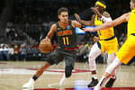 Atlanta Hawks guard Trae Young (11) is defended by Indiana Pacers guard Aaron Holiday (3) in the first half of an NBA basketball game Friday, Dec. 13, 2019, in Atlanta, Ga. (AP Photo/Brett Davis)