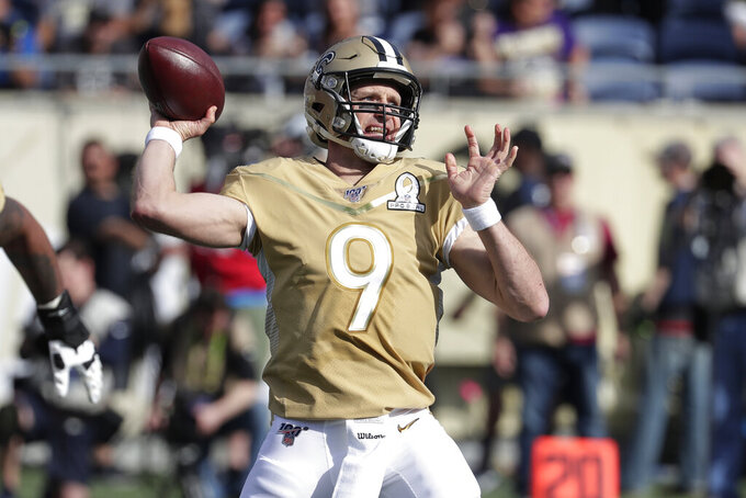 "FILE - In this Jan. 26, 2020, file photo, NFC quarterback Drew Brees, of the New Orleans Saints, (9) looks to pass during the first half of the NFL Pro Bowl football game in Orlando, Fla. Atlanta Falcons coach Dan Quinn says the NFC South ""is turning into Quarterback South."" The priority to ""bring it"" on defense was evident in the NFL draft. (AP Photo/John Raoux, File)"