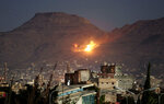 FILE - In this Oct. 14, 2016 file photo, fire and smoke rise after a Saudi-led airstrike hit a site believed to be one of the largest weapons depots on the outskirts of Yemen's capital, Sanaa. A database tracking violence said Wednesday, June 19, 2019 that at least 91,600 people have been killed in Yemen's civil war, presenting a new estimate after completing reporting for the first months of fighting in 2015. (AP Photo/Hani Mohammed, File)