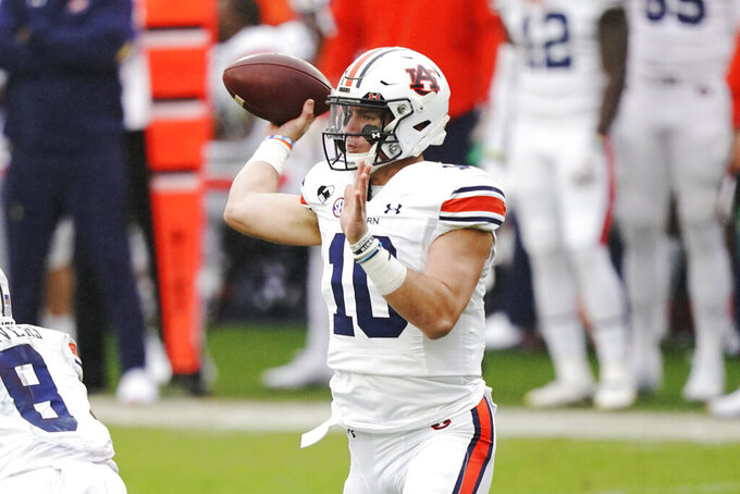 Auburn quarterback Bo Nix (10) passes against Mississippi during the first half of an NCAA college football game in Oxford, Miss., Saturday Oct. 24, 2020. (AP Photo/Rogelio V. Solis)