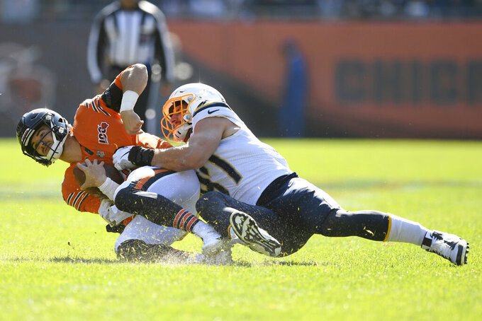 Chicago Bears quarterback Mitchell Trubisky is sacked by Los Angeles Chargers defensive end Joey Bosa, right, during the first half of an NFL football game, Sunday, Oct. 27, 2019, in Chicago. (AP Photo/Paul Beaty)