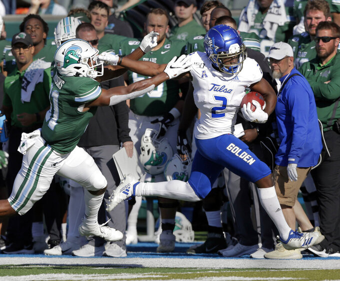 Tulsa wide receiver Keylon Stokes (2) sprints past Tulane safety Larry Brooks (31) during an NCAA college football game in New Orleans, La., Saturday, Nov. 2, 2019. (A.J. Sisco/The Advocate via AP)