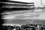 FILE - This Oct. 4, 1944, file photo shows St. Louis Cardinals' Ray Sanders striking out on a pitch from St. Louis Browns' Denny Galehouse during the first inning of the first game of the World Series at Sportsman's Park in St. Louis. The last time the World Series was held in a single ballpark was in 1944. (AP Photo/File)