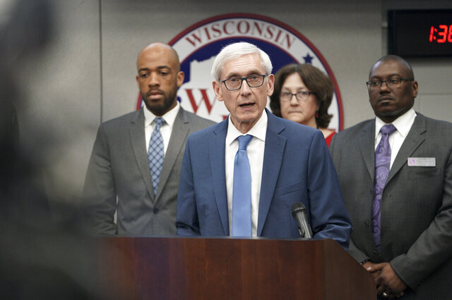 FILE - In this March 12, 2020 file photo, Gov. Tony Evers declares a public health emergency in Madison, Wis. Evers has ordered a ban on all gatherings of more than 50 people, a dramatic move in line with federal recommendations as other states took similar action to stop the spread of the new coronavirus. Evers tweeted Monday, March 16, 2020that he was ordering the ban, but said