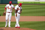 St. Louis Cardinals starting pitcher Carlos Martinez, right, stands on the mound next to teammate Paul DeJong (11) while waiting to be removed during the fourth inning in the first game of a baseball doubleheader against the Minnesota Twins Tuesday, Sept. 8, 2020, in St. Louis. (AP Photo/Jeff Roberson)