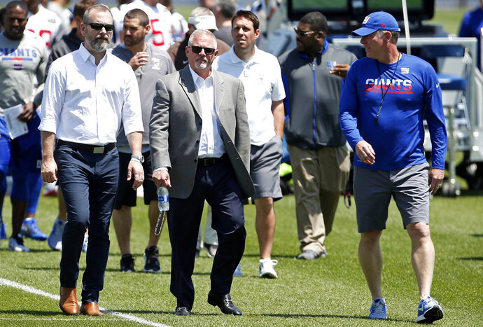 New York Giants head coach Pat Shurmur, right, walks off the field  assistant general nanager Kevin Abrams, left, and senior vice president, communications Pat Hanlon after the team's NFL football practice, Tuesday, June 12, 2018, in East Rutherford, N.J. (AP Photo/Adam Hunger)