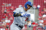 Los Angeles Dodgers' Joc Pederson runs the bases after hitting a solo home run off Cincinnati Reds starting pitcher Anthony DeSclafani in the third inning of a baseball game, Friday, May 17, 2019, in Cincinnati. (AP Photo/John Minchillo)