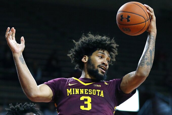 FILE - In this Nov. 26, 2018, file photo, Minnesota's Jordan Murphy grabs a rebound during the first half of an NCAA college basketball game against Boston College, in Boston. Jordan Murphy has had to slog through a couple of rough seasons at Minnesota to become the Big Ten's second-leading rebounder of all time. Dupree McBrayer is still hurting from his mother's death a little more than three months ago. The seniors still have a chance to end their career with the Gophers on a brighter note.(AP Photo/Michael Dwyer, File)