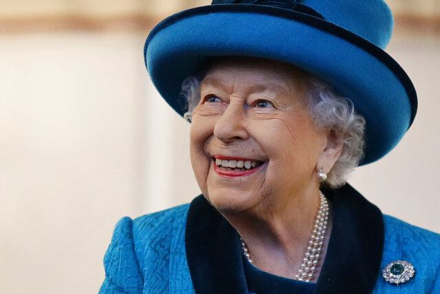 """FILE - In this Tuesday, Nov 26, 2019 file photo, Britain's Queen Elizabeth II visits the new headquarters of the Royal Philatelic society in London. Britain is marking Queen Elizabeth II's 94th birthday, Tuesday, April 21, 2020, with silence, as the nation in lockdown amid the COVID-19 pandemic forgoes the usual gun salutes and ringing of bells. With thousands dead, the monarch decided that the celebratory display of military firepower would not be """"appropriate.'' Nor will there be a celebratory peal of bells from Westminster Abbey, as the church where the queen was married and crowned is currently closed. (Tolga Akmen/Pool via AP, File)"""