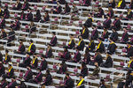 In this March 12, 2021, photo, graduates wait to cross the stage during a Texas A&M University makeup graduation ceremony for spring and summer 2020 graduates, at Kyle Field in College Station, Texas. Scores of campuses around the U.S. are offering last year's graduates a chance to experience the in-person commencements they missed out on when the pandemic upended life. Some are inviting them to join in festivities for the Class of 2021, while others are hosting separate commencements for them this spring or special events later this year. (Michael Miller/College Station Eagle via AP)