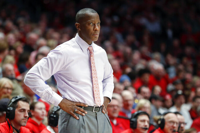 FILE - In this Jan. 22, 2020, file photo, Dayton head coach Anthony Grant watches his players from the bench during the second half of an NCAA college basketball game against St. Bonaventure, in Dayton, Ohio. Grant was named the AP coach of the year, Tuesday, March 24, 2020. (AP Photo/John Minchillo, File)