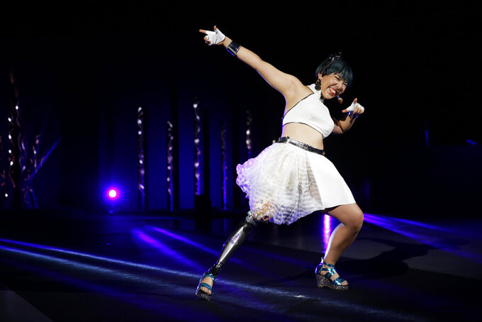 """Kaede Maegawa, a Paralympian, participates in a fashion show dubbed """"Amputee Vinus Show"""" in Tokyo on Tuesday, Aug. 25, 2020. The fashion show was held in conjunction with the opening of the Tokyo Paralympic Games, now scheduled to open on Aug. 24, 2021. (AP Photo/Hiro Komae)"""