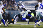 Philadelphia Eagles free safety Rodney McLeod tries to stop Dallas Cowboys running back Ezekiel Elliott (21) during the second half of an NFL football game Sunday, Dec. 22, 2019, in Philadelphia. (AP Photo/Michael Perez)
