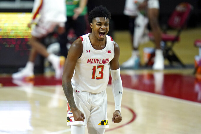 Maryland guard Hakim Hart reacts after scoring a three-point shot against St. Peter's during the first half of an NCAA college basketball game, Friday, Dec. 4, 2020, in College Park, Md. (AP Photo/Julio Cortez)