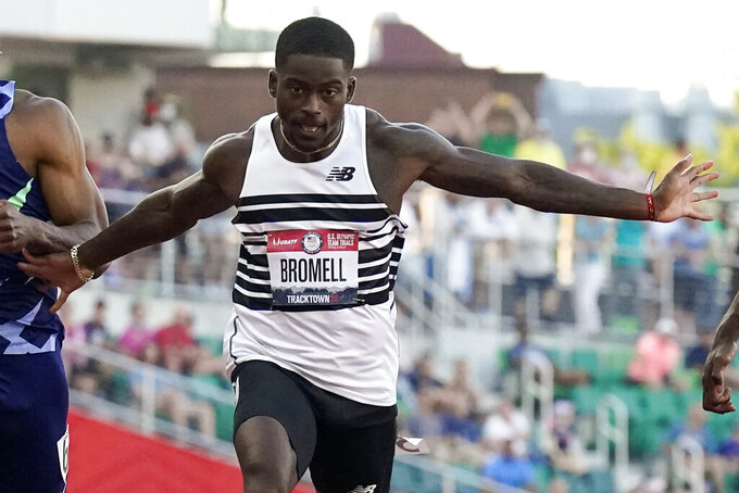 FILE - In this June 20, 2021, file photo, Trayvon Bromell wins the men's 100-meter run at the U.S. Olympic Track and Field Trials in Eugene, Ore. Bromell is the favorite in the 100 at the upcoming Tokyo Games. (AP Photo/Ashley Landis, File)