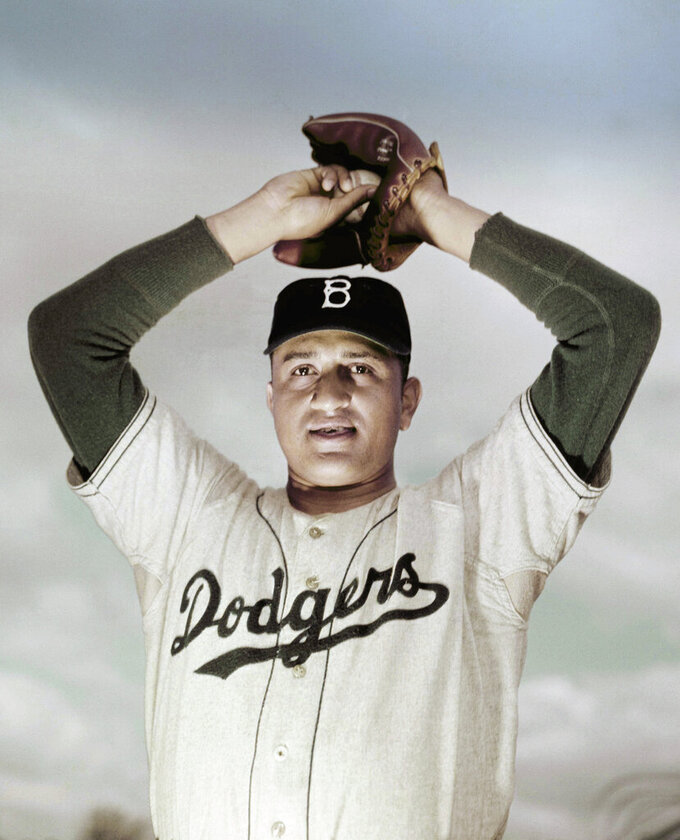 FILE - This is a March 1951, file photo showing Brooklyn Dodgers pitcher Don Newcombe. Newcombe, the hard-throwing Brooklyn Dodgers pitcher who was one of the first black players in the major leagues and who went on to win the rookie of the year, Most Valuable Player and Cy Young awards, died Feb 19, 2019. He was 92. (AP Photo/File)