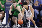 North Dakota forward Brady Danielson, left, and Gonzaga guard Ryan Woolridge go after the ball during the first half of an NCAA college basketball game in Spokane, Wash., Tuesday, Nov. 12, 2019. (AP Photo/Young Kwak)