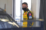 Christopher Bell waits in his garage before the start of a NASCAR Daytona 500 auto race practice session at Daytona International Speedway, Wednesday, Feb. 10, 2021, in Daytona Beach, Fla. (AP Photo/John Raoux)