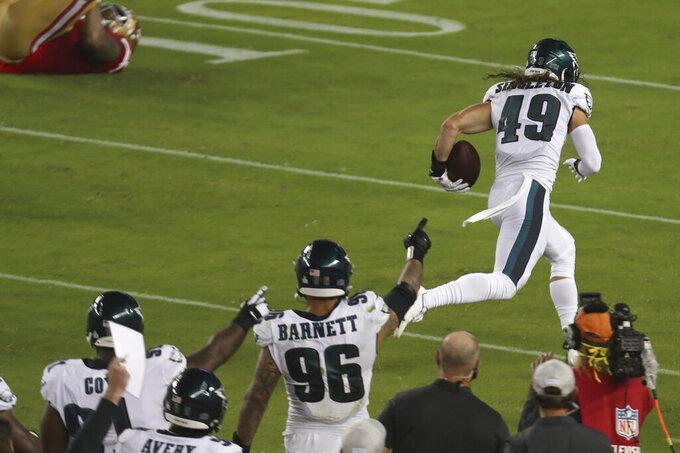 Philadelphia Eagles linebacker Alex Singleton (49) returns an interception for a touchdown against the San Francisco 49ers during the second half of an NFL football game in Santa Clara, Calif., Sunday, Oct. 4, 2020. (AP Photo/Jed Jacobsohn)