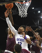 Prairie View A&M forward Iwin Ellis (13) blocks a shot by Texas Southern center Trayvon Reed (5) during the first half of the SWAC championship NCAA college basketball game Saturday, March 16, 2019, in Birmingham, Ala. (AP Photo/Julie Bennett)