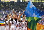 FILE - In this July 5, 2015 file photo, confetti floats down as the United States women's national team celebrate with the trophy after beating Japan 5-2 in the FIFA Women's World Cup soccer championship in Vancouver, British Columbia, Canada. When FIFA released its global strategy for women's soccer last year, it was met by some skepticism. But soccer's governing body is making some strides in implementing the long-range plan, against a backdrop of this summer's World Cup in France.  (AP Photo/Elaine Thompson, File)